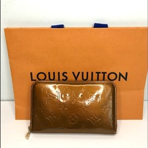 Authentic Louis Vuitton zip around gold wallet